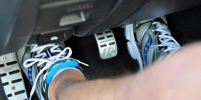 Resting your foot on the clutch pedal